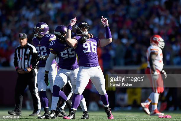 Harrison Smith Anthony Barr and Brian Robison of the Minnesota Vikings celebrate a fumble recovery by Robison during the fourth quarter of the game...
