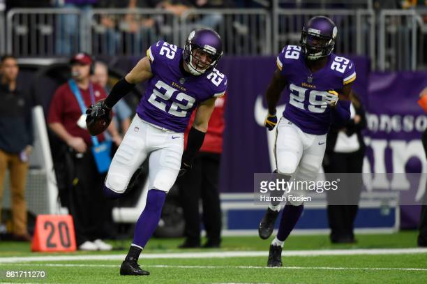 Harrison Smith of and Xavier Rhodes of the Minnesota Vikings celebrate an interception by Smith during the fourth quarter of the game against the...