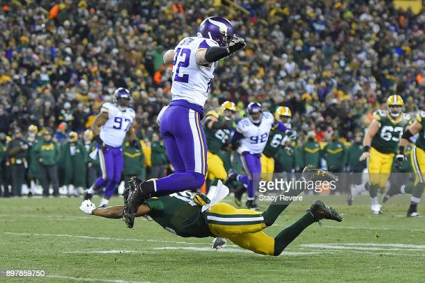 Harrison Smith of the Minnesota Vikings avoids a tackle by Randall Cobb of the Green Bay Packers after an interception in the first half at Lambeau...