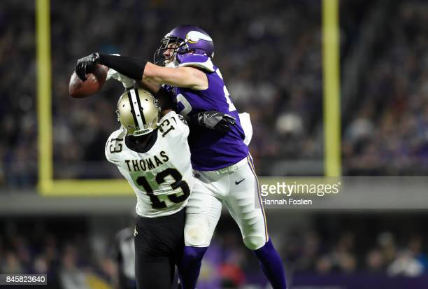 Harrison Smith of the Minnesota Vikings bats the ball away from Michael Thomas of the New Orleans Saints in the second half of the game on September...