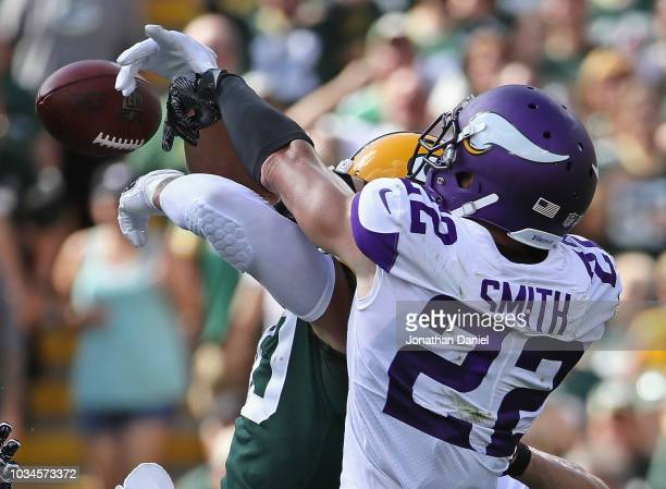 Harrison Smith of the Minnesota Vikings breaks up a pass intended for Jimmy Graham of the Green Bay Packers at Lambeau Field on September 16 2018 in...