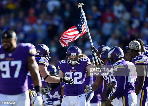 Harrison Smith of the Minnesota Vikings carries a flag onto the field before the game against the St Louis Rams on November 8 2015 at TCF Bank...