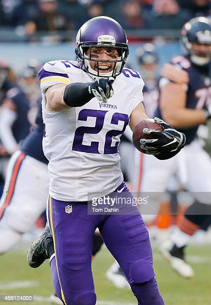 Harrison Smith of the Minnesota Vikings carries the ball following an interception during an NFL game against the Chicago Bears at Soldier Field...