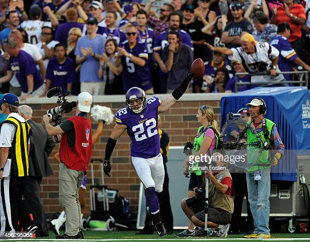 Harrison Smith of the Minnesota Vikings celebrates catching an interception against the Atlanta Falcons during the fourth quarter of the game on...