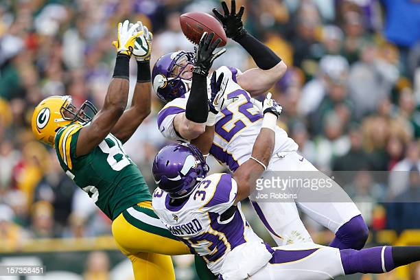 Harrison Smith of the Minnesota Vikings intercepts a pass intended for Greg Jennings of the Green Bay Packers during the game at Lambeau Field on...