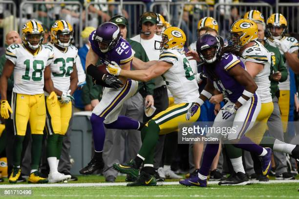 Harrison Smith of the Minnesota Vikings is forced out of bounds by Jordy Nelson of the Green Bay Packers after an interception during the fourth...