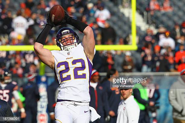 Harrison Smith of the Minnesota Vikings makes a catch during warm ups before the game against the Chicago Bears at Soldier Field on November 25 2012...