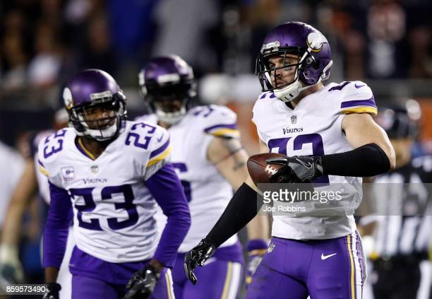 Harrison Smith of the Minnesota Vikings reacts after intercepting the football in the fourth quarter against the Chicago Bears at Soldier Field on...