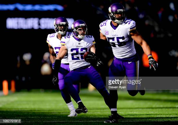 Harrison Smith of the Minnesota Vikings returns an interception with teammates Xavier Rhodes and Anthony Barr of the Minnesota Vikings during the...