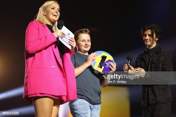 Harrison Wright is presented with the Teen Hero award on stage by Katie Thistleton and Cel Spellman at the BBC Radio 1 Teen Awards 2017 at Wembley...