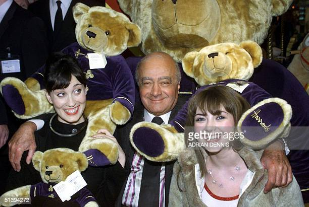 Harrods Chairman Mohamed Al Fayed cuddles singers Charlotte Church and Filippa Giordano amongst the teddy bears in the exclusive department store in...