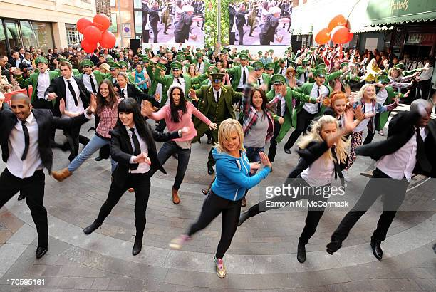 Harrods Doorman starts flash mob dance routine at the Harrods Summer Sale launch photocall at Harrods on June 15, 2013 in London, England.