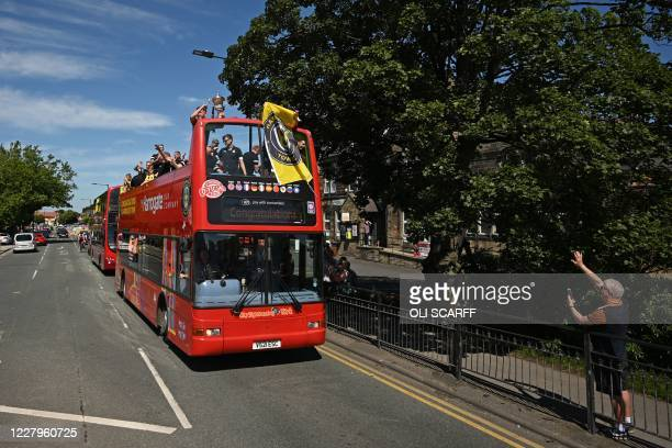 Harrogate Town players, families and officials celebrate their promotion to the football league with an open-top bus parade through the streets of...
