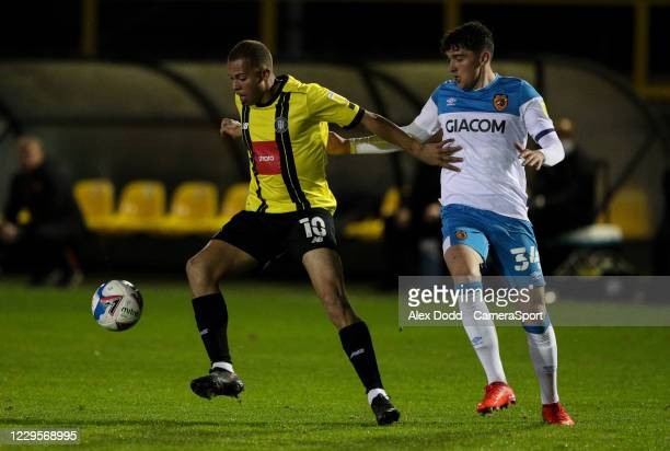 Harrogate Town's Aaron Martin shields the ball from Hull City's Callum Jones during the EFL Trophy Northern Group H match between Harrogate Town and...