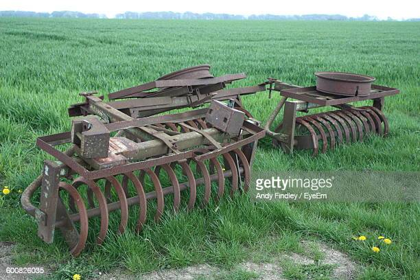 harrows on agricultural field - tiller stock photos and pictures