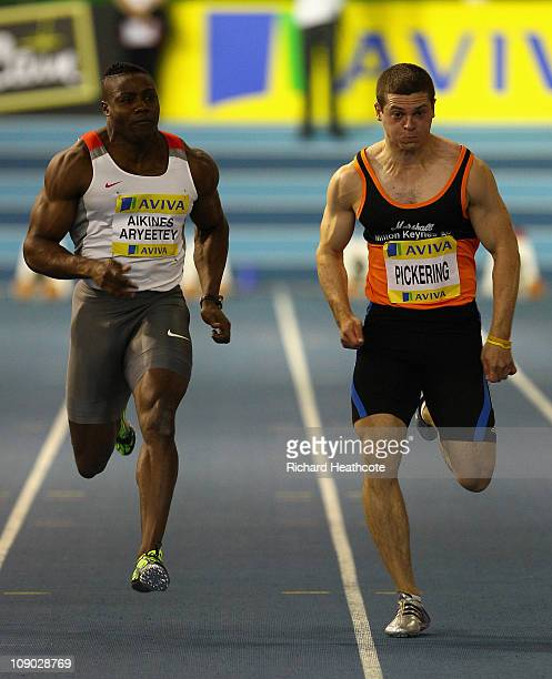 Harry Aikines Aryeetey and Craig Pickering in action during the 60m sprint semi final during the AVIVA European Trials UK Championship at the English...