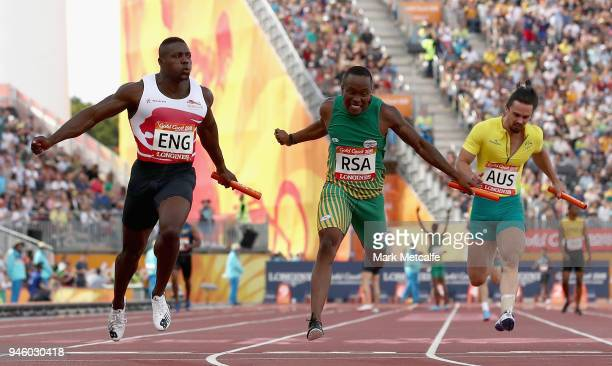 Harry AikinesAryeetey of England crosses the line to win gold ahead of Akani Simbine of South Africa and Josh Clarke of Australia in the Men's 4x100...