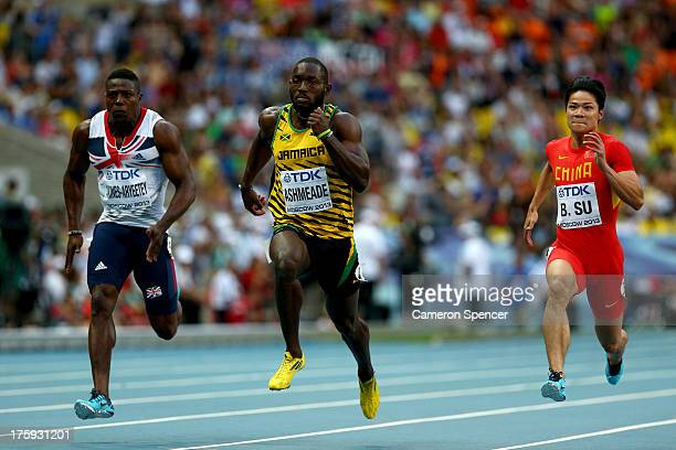 Harry AikinesAryeetey of Great Britain Nickel Ashmeade of Jamaica and Bingtian Su of China compete in the Men's 100 metres heats during Day One of...