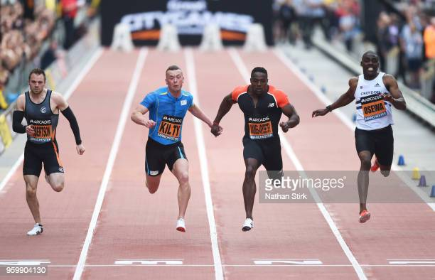 Harry AikinesAryeetey of Great Britain wins the 100 metre sprint during the Great City Games on May 18 2018 in Manchester England