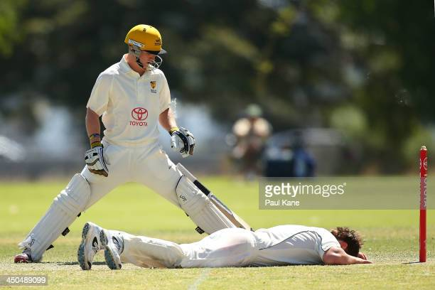 Harry Allanby of Tasmania lies on the wicket after missing a catch as Jaron Morgan of Western Australia looks on during day two of the Futures League...