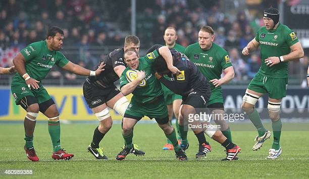 Harry Allen of London Irish is tackled during the Aviva Premiership match between Saracens and London Irish at Allianz Park on January 3 2015 in...