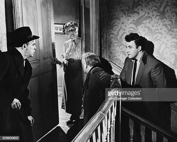 Harry and Louis look at each other in dismay as Mrs Wilberforce known affectionately as Mum opens the door at the Professor's touch and they realize...