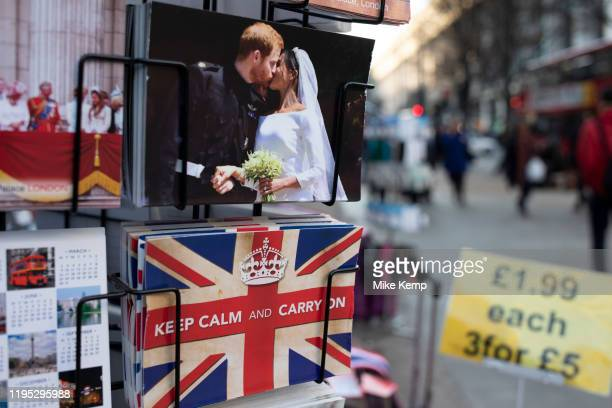 Harry and Meghan postcards for sale next to a Union Jack flag card with the slogan 'Keep Calm And Carry On' as if they are kissing goodbye to the UK...