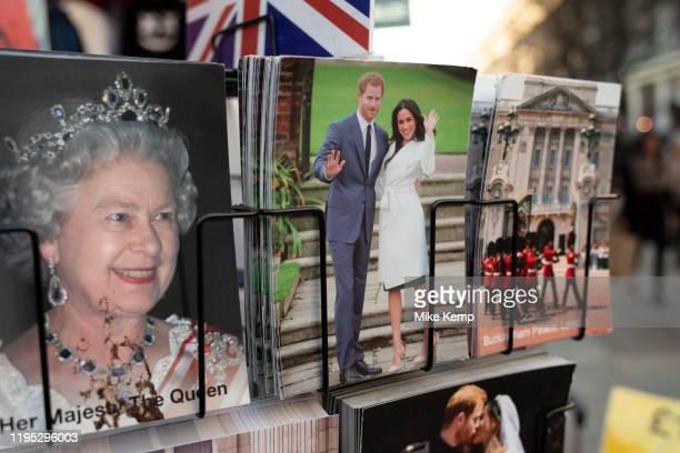 Harry and Meghan postcards next to a postcard of Queen Elizabeth II for sale as if they are waving goodbye to the UK on a rack on 21st January 2020...