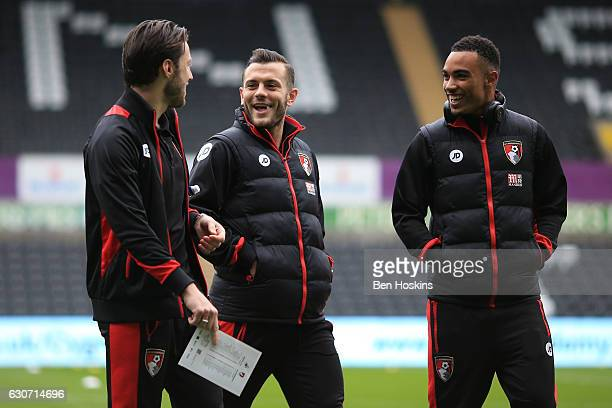 Harry Arter Jack Wilshere and Junior Stanislas of AFC Bournemouth look on prior to the Premier League match between Swansea City and AFC Bournemouth...