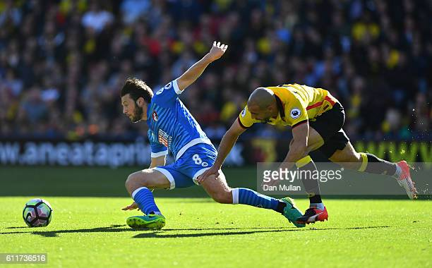 Harry Arter of AFC Bournemouth and Nordin Amrabat of Watford battle for possession during the Premier League match between Watford and AFC...