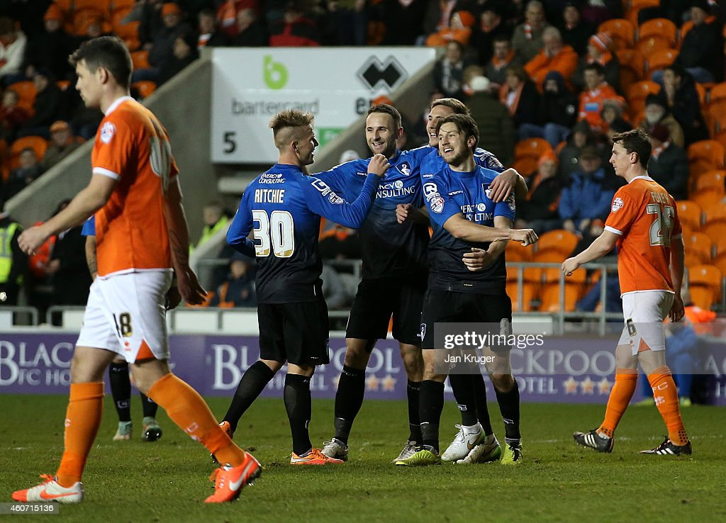Harry Arter of AFC Bournemouth celebrates his goal with team mates during the Sky Bet Championship match between Blackpool and Bournemouth at Bloomfield Road on December 20, 2014 in Blackpool, England.