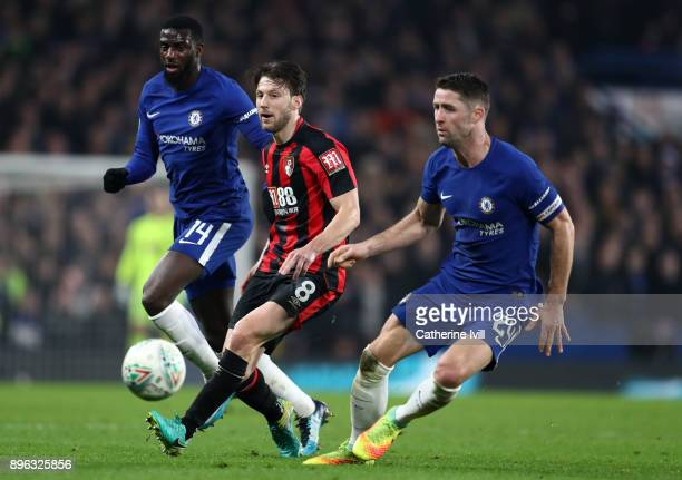 Harry Arter of AFC Bournemouth in action Tiemoue Bakayoko of Chelsea and Gary Cahill of Chelsea during the Carabao Cup QuarterFinal match between...