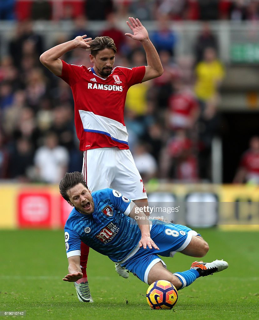 Harry Arter of AFC Bournemouth is challenged by Gaston Ramirez of Middlesbrough during the Premier League match between Middlesbrough and AFC Bournemouth at the Riverside Stadium on October 29, 2016 in Middlesbrough, England.