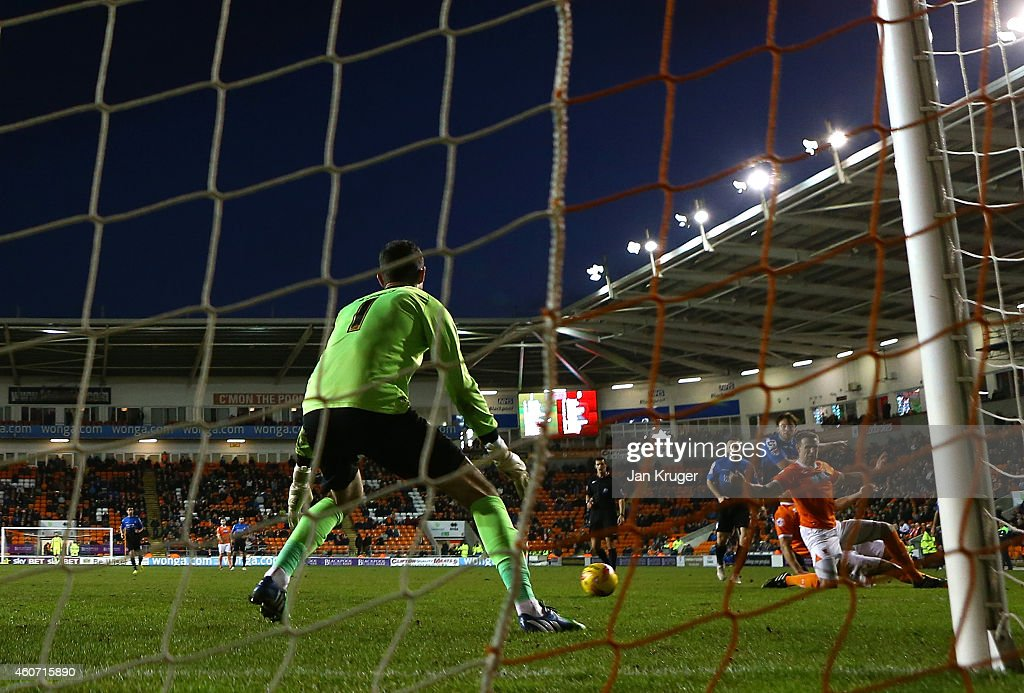 Harry Arter of AFC Bournemouth steers the ball past Joe Lewis, Goalkeeper of Blackpool for his goal during the Sky Bet Championship match between Blackpool and Bournemouth at Bloomfield Road on December 20, 2014 in Blackpool, England.