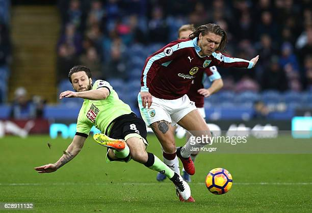 Harry Arter of AFC Bournemouth tackles Jeff Hendrick of Burnley during the Premier League match between Burnley and AFC Bournemouth at Turf Moor on...
