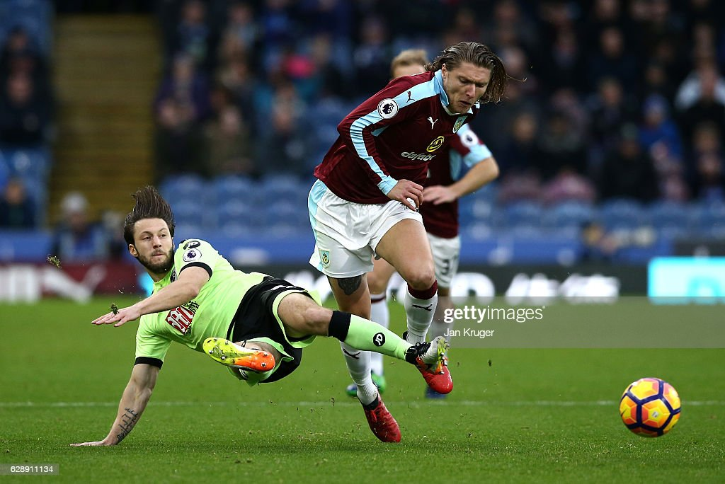 Harry Arter of AFC Bournemouth (L) tackles Jeff Hendrick of Burnley (R) during the Premier League match between Burnley and AFC Bournemouth at Turf Moor on December 10, 2016 in Burnley, England.
