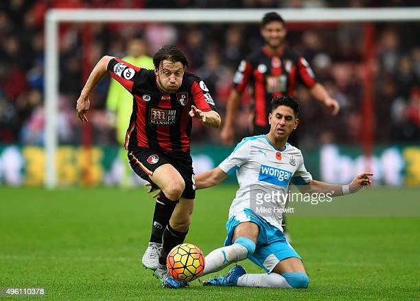 Harry Arter of Bournemouth and Ayoze Perez of Newcastle United compete for the ball during the Barclays Premier League match between AFC Bournemouth...