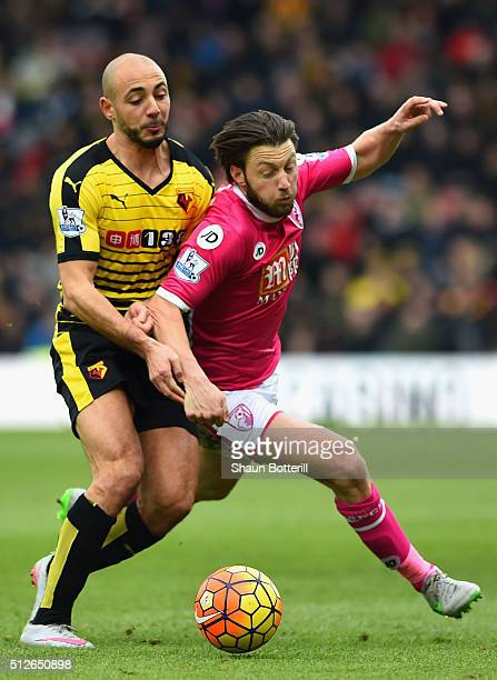 Harry Arter of Bournemouth and Nordin Amrabat of Watford compete for the ball during the Barclays Premier League match between Watford and AFC...