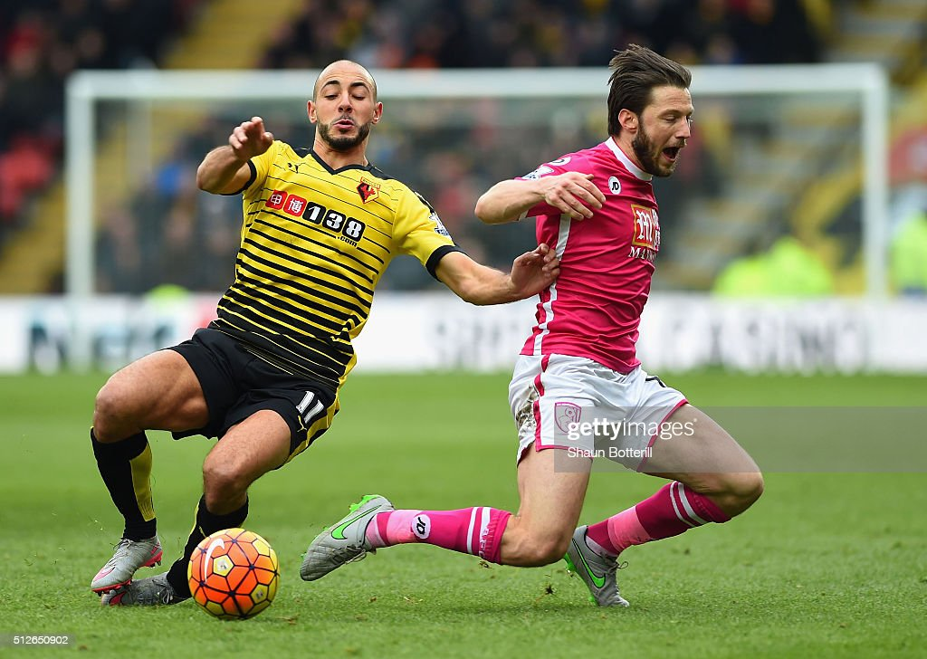 Harry Arter of Bournemouth and Nordin Amrabat of Watford compete for the ball during the Barclays Premier League match between Watford and A.F.C. Bournemouth at Vicarage Road on February 27, 2016 in Watford, England.