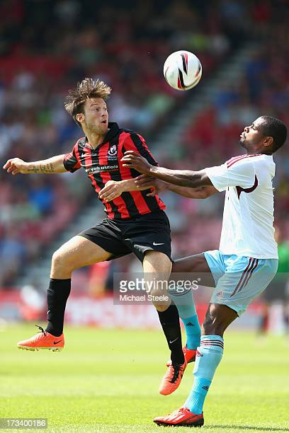 Harry Arter of Bournemouth challenges Ricardo Vaz Te of West Ham United during the Pre Season Friendly match between Bournemouth and West Ham United...