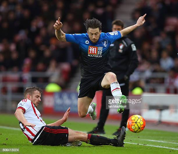 Harry Arter of Bournemouth is tackled by Lee Cattermole of Sunderland during the Barclays Premier League match between Sunderland and AFC Bournemouth...