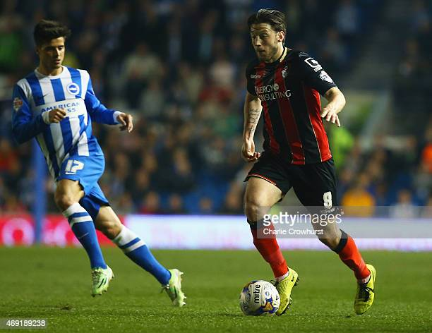 Harry Arter of Bournemouth is watched by Joao Carlos Teixeira of Brighton and Hove Albion during the Sky Bet Championship match between Brighton Hove...