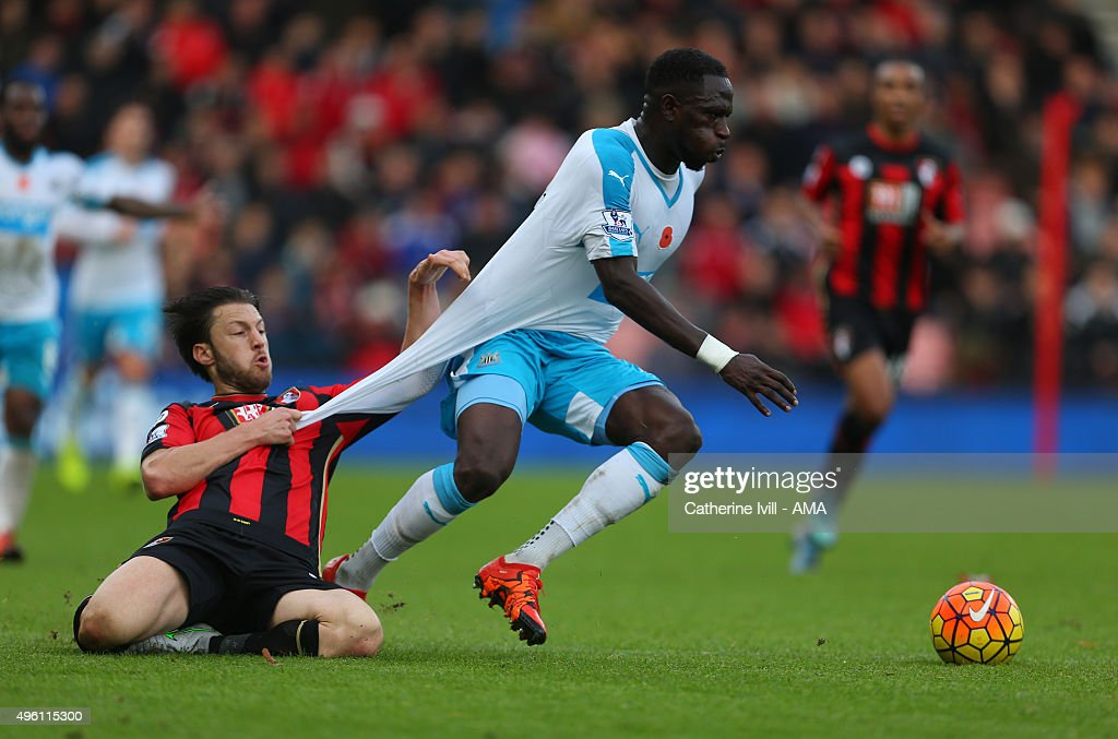 Harry Arter of Bournemouth pulls the shirt of Moussa Sissoko of Newcastle United during the Barclays Premier League match between AFC Bournemouth and Newcastle United at Vitality Stadium on November 7, 2015 in Bournemouth, England.