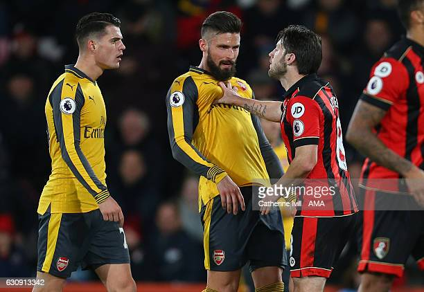 Harry Arter of Bournemouth pushes back Olivier Giroud of Arsenal as he has words with Granit Xhaka of Arsenal during the Premier League match between...