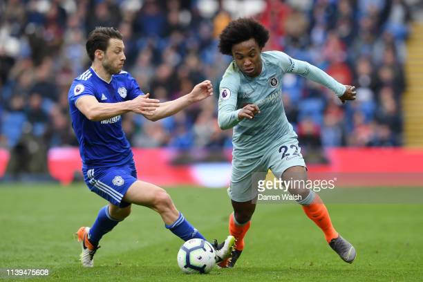 Harry Arter of Cardiff City looks on as Willian of Chelsea controls the ball during the Premier League match between Cardiff City and Chelsea FC at...