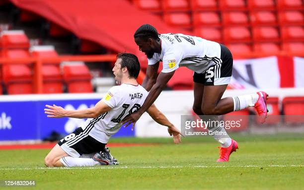 Harry Arter of Fulham is congratulated by Joshua Onomah of Fulham after scoring the opening goal during the Sky Bet Championship match between...