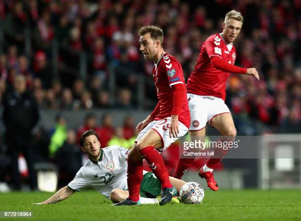 Harry Arter of the Republic of Ireland is tackled by Christian Eriksen of Denmark and Nicolai Jorgensen of Denmark during the FIFA 2018 World Cup...