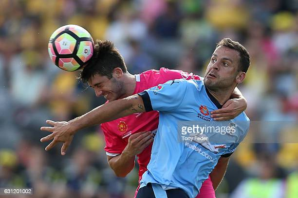 Harry Ascroft of the Mariners and Bobo of Sydney FC contest the ball during the round 14 ALeague match between the Central Coast Mariners and Sydney...
