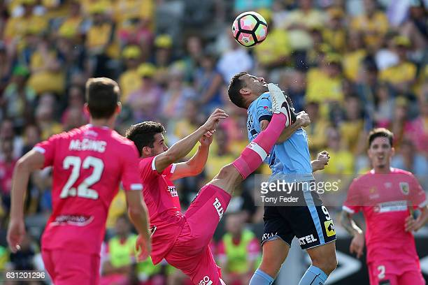 Harry Ascroft of the Mariners and Bobo of Sydney FC contest the ball during the round 14 A-League match between the Central Coast Mariners and Sydney...