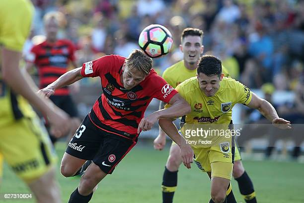 Harry Ascroft of the Mariners and Bruno Pinatares of the Wanderers contest the ball during the round nine A-League match between Central Coast...